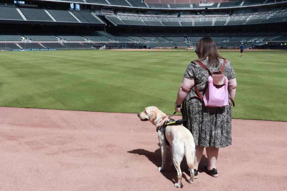 Katie Hearn stands on the outfield warning track at SunTrust Park